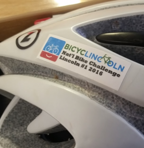 Get your helmet sticker at Commuter Club or other cycling events around town.